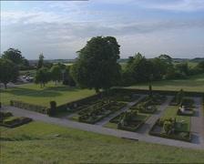 JELLING  graveyard  + pan in rural landscape Stock Footage