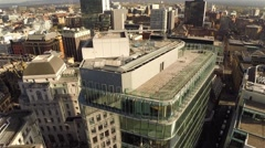 Manchester UK Aerial city landscape, circuling over office building. Stock Footage
