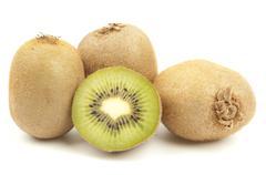 whole kiwi fruit and his segments isolated on white background cutout - stock photo