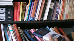 books ,browsing the home library Stock Footage