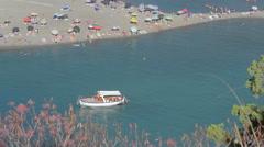 Pedaloas,boats and bathers Stock Footage
