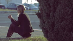 depressed woman sitting alone with problems: sad, thoughts, sadness, depression - stock footage