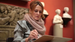 Female artist painting in the Pushkin Museum of Fine Arts in Moscow. Stock Footage