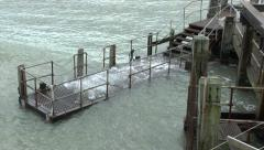 Ocean Waves Coming Through The Boat Landing Decking Stock Footage