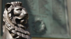 War memorial pull focus lion to plaque Stock Footage
