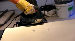 Cutting and preparing metal sheet  with an electric handsaw - stock footage