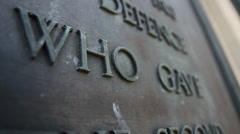 War memorial plaque close up words Stock Footage