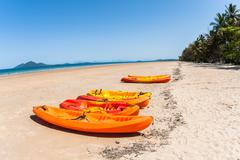 kayak canoes beach ocean - stock photo