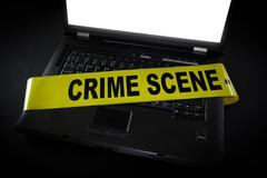 Laptop with crime scene tape across it Stock Photos