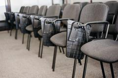 Row of chairs in conference rom university Stock Photos