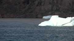 Greenland Prince Christian Sound 061 white iceberg swims in blue ice water - stock footage