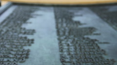 War Memorial Plaque Extreme low angle Stock Footage