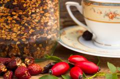 fresh and dried rose hip on the table - stock photo