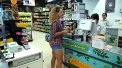 Woman Paying Cash with Thai Money Bill at Supermarket Checkout. Stock Footage