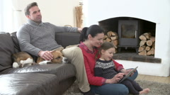 Family Relaxing Watching Television And Using Digital Tablet Stock Footage
