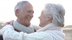 Romantic Senior Couple Embracing On Winter Beach In Slow Motion Stock Footage