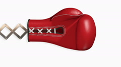 A Comical Red Boxing Glove on Extension Scissors - stock footage