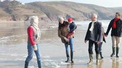 Multi Generation Family Walking On Winter Beach Stock Footage