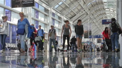 Time lapse low angle-travelers at Chicago OHare airport Stock Footage