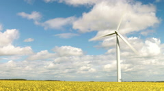 Time Lapse Sequence Of Wind Turbine In Field Of Rape Stock Footage