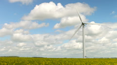 Wind Turbine In Field Of Oilseed Rape Stock Footage
