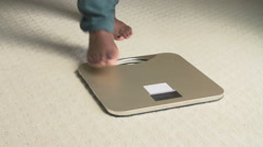 Happy Overweight Woman Standing On Scales In Bedroom Stock Footage