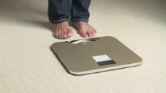 Unhappy Overweight Woman Weighing Herself On Scales Stock Footage