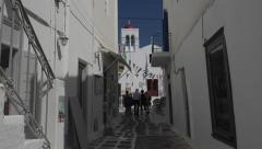 Mykonos Greece tourists white washed street alley 4K 129 Stock Footage
