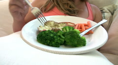 Overweight Woman Eating Healthy Meal Sitting On Sofa Stock Footage