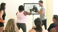 Fitness Instructor In Exercise Class For Overweight People Stock Footage