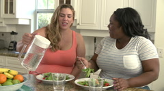 Two Overweight Women On Diet Eating Healthy Meal In Kitchen Stock Footage