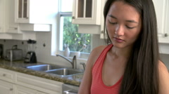 Young Woman Preparing Bowl Of Fresh Fruit In Kitchen Stock Footage