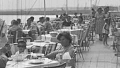 Mamaia 1960s: people eating in front of the sea Stock Footage