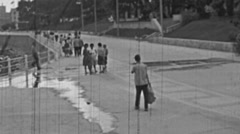 Mamaia 1960s: people walking in front of the sea Stock Footage
