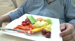 Overweight Man Eating Healthy Meal Sitting On Sofa Arkistovideo