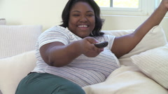 Overweight Woman At Home Watching TV And Laughing Stock Footage