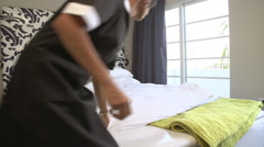 Maid Tidying Hotel Room And Making Bed Stock Footage