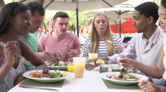 Group Of Friends Enjoying Lunch In Outdoor Restaurant Stock Footage