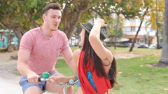 Young Couple Having Fun On Bicycle Ride Stock Footage