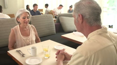 Waitress Serving Senior Couple Breakfast In Hotel Restaurant - stock footage