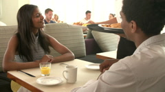 Waitress Serving Couple Breakfast In Hotel Restaurant - stock footage
