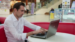 Man in despair and hesitant at work with a laptop Stock Footage