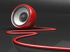 red speaker with cable over grey background - stock illustration