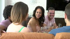 Group Of Friends Relaxing On Sofa And Drinking Wine Stock Footage