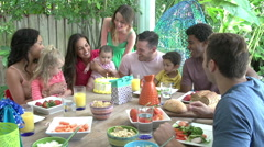 Group Of Families Celebrating Child's Birthday At Home Stock Footage