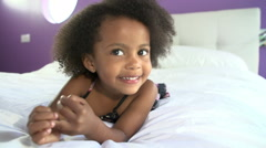 Cute Little Girl Lying On Tummy In Parent's Bed - stock footage