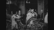 Royal women entering horse carriage with guards Stock Footage