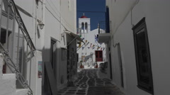 Mykonos Greece white washed alley church 4K 128 Stock Footage