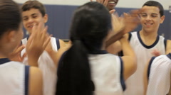 High School Students Celebrating Sports Win In Gym - stock footage