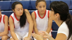 Coach Of Female High School Basketball Team Gives Team Talk Stock Footage